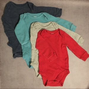 4 pack Carter's long sleeve onesies